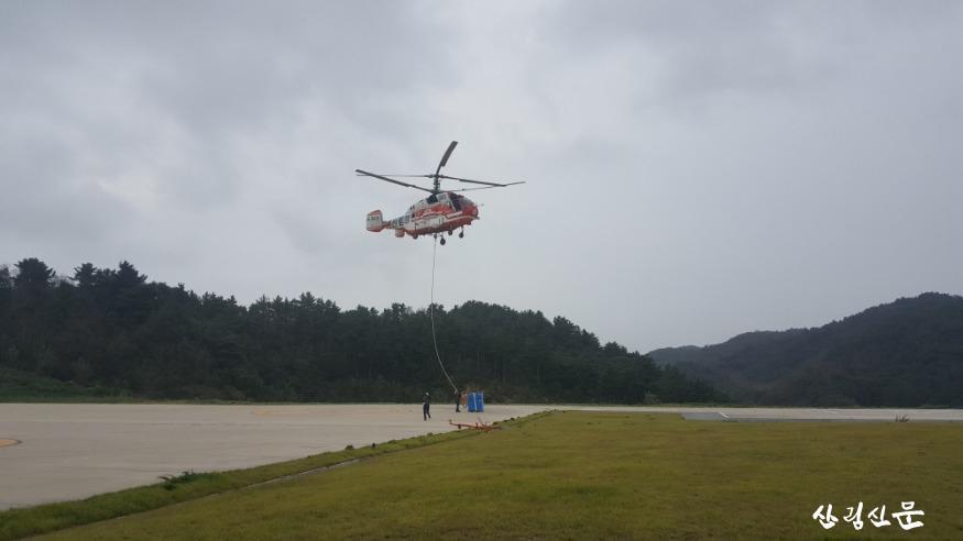 구호 물자운반 헬기이륙.jpg